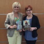 Brenda and Jayne Ann Krentz holding similar titled books