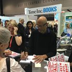 Brenda getting a book signed by Kareem Abdul-Jabbar at BEA 2016